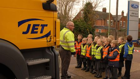 Perry Southgate, of Suckling Transport, with Edgar Sewter Primary School pupils. Picture: Jet