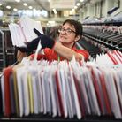 Norwich Royal Mail sorting office staff processing Christmas cards and gifts on their busiest day of