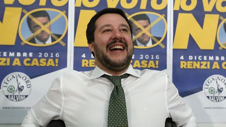 Northern League's leader Matteo Salvini smiles at his party's headquarters where he was waiting for