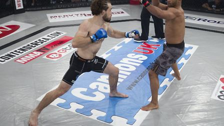 Corrin Eaton, left, looks to land a big right hand in his fight with Igor Camino-Mora