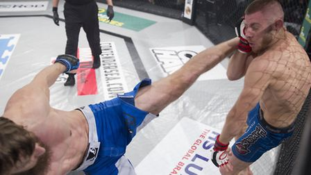 Kim Thinghaugen, left, lands a head kick on his way to victory against Andre Goncalves