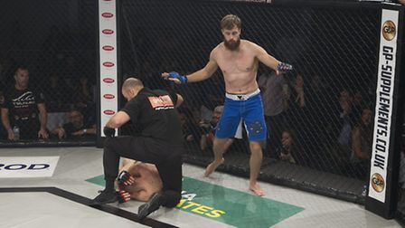 Referee Dan Movahedi steps in to stop the fight as Kim Thinghaugen beats Andre Goncalves in the firs
