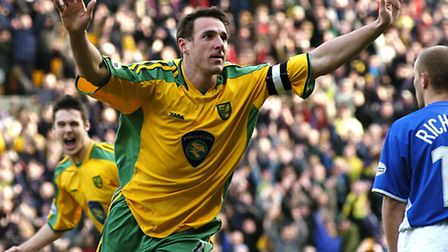 Mackay celebrates the first of his two goals against Ipswich, in a 3-1 win for Norwich at Carrow Roa