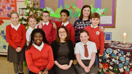 Barnham School celebrate their outstanding SIAMs. Headteacher Amy Arnold (in black) with assistant h
