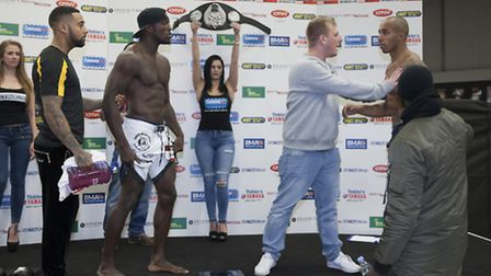 The fighters are separated after clashing at the weigh-ins