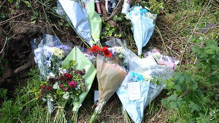 Flowers left at the scene of the crash on the B1355. Picture: Chris Bishop