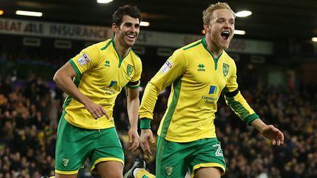 Alex Pritchard celebrates scoring his side's fifth goal in Norwich City's demolition of Brentford at