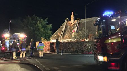 Fire crews on the scene of a fire at a thatched house in Great Hockham. Picture by Bethany Whymark
