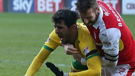 Rotherham's Kirk Broadfoot wrestles Nelson Oliveira to the ground in the incident that led up to the