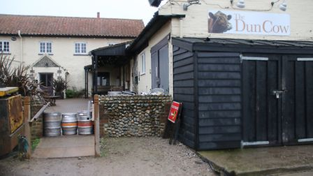 The Dun Cow pub in Salthouse used beer barrels to block the path of the rising water. Picture: ALLY