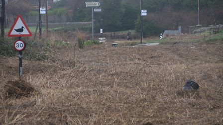 The A149 Coast Road in Salthouse is almost recognisable two days after the debris. Caked in debris d