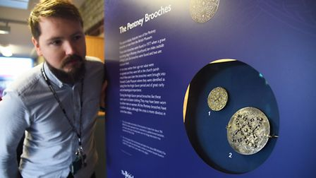 Carl Hutchings looking at the Pentney Brooches that are on display in the Lynn Museum. Picture: Ian