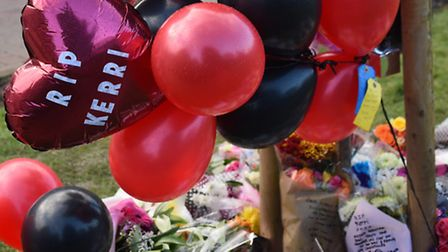 Balloons and flowers in tribute to murdered Kerri McAuley at Southalls Way. Picture: DENISE BRADLEY