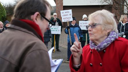 Placard-waving protesters objected to the proposed development during a site visit in Weybourne. Pic