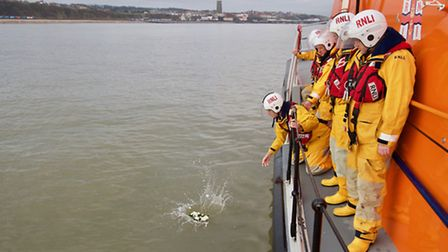 Cromer lifeboat crew laid in wreath in memory of those who lost their lives in a rescue off the coas