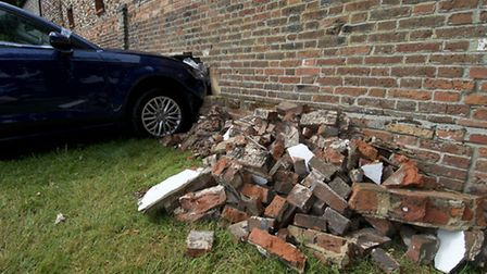 The car which crashed into a garage in Holt on Friday 22nd July. Picture: MARK BULLIMORE