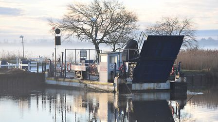 A vehicle submerged under water and lodged under the chains of Reedham Ferry where the ferry docks o