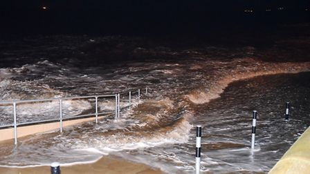 The rising storm surge water breaking onto the promenade defences at Lowestoft. Picture: James Bass
