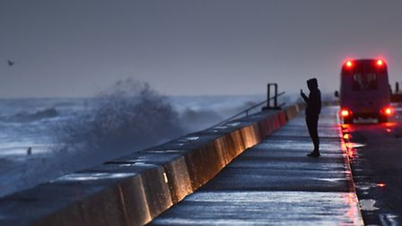Rough seas batter Walcott as dawn brakes on the Norfolk coast as spring tides, high winds and winter
