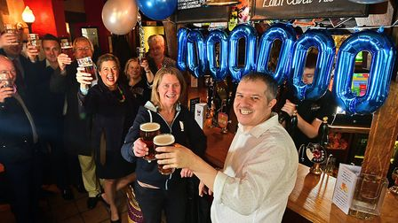 Phil Cutter celebrates pulling his one millionth pint as landlord of The Murderers pub in Norwich. P