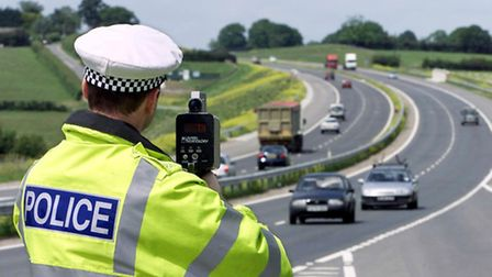 Police officers issue training to volunteers in how to use speed guns