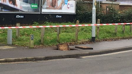 The manhole cover blown upwards by an explosion on Dereham Road. PICTURE: Dan Grimmer