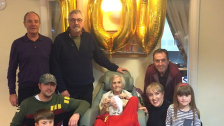 Dorothy McKechnie celebrates her 100th birthday with her family. Top from left: Dorothy's sons Andre