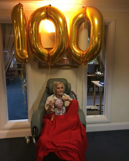 Dorothy McKechnie celebrates her 100th birthday and with her card from the Queen. Picture: Rebecca M