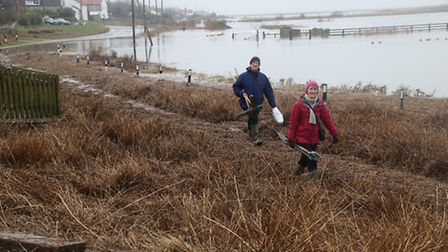 This couple were preparing to dig their way out of Salthouse. Picture: ALLY McGILVRAY