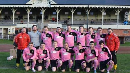 Great Yarmouth Town players in pink kits, which they will wear on Saturday against Clacton. Picture: