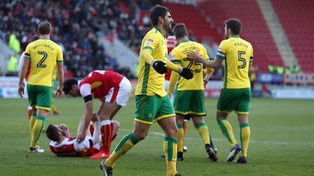 Nelson Oliveira of Norwich tangles with Kirk Broadfoot of Rotherham United and is sent off by Refere