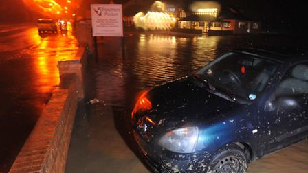 Walcott faces the high tides, strong winds and tidal surge as the sea closes the main road and local