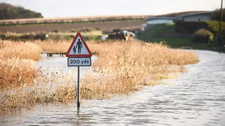 The main road through Cley was closed because of flooding. Picture: Ian Burt