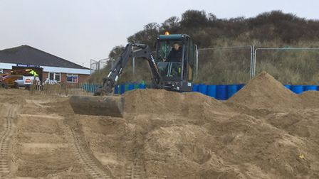 Repair work is carried out to Hemsby beach following the tidal surge.
