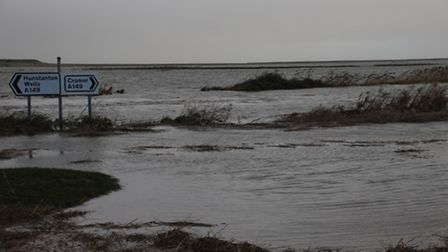 The A149 Coast Road was submerged by the sea in Salthouse. Picture: ALLY McGILVRAY