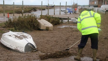 Residents rallied round to clear the sea debris from the quayside in Blakeney. Picture: ALLY McGILVR