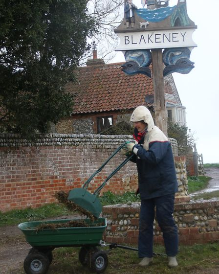 The community rallied round to clear the sea debris from the streets in Blakeney. Picture: ALLY McGI