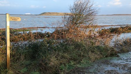 Salthouse crept ever closer to the sea after the storm surge broke through its natural defences. Pic