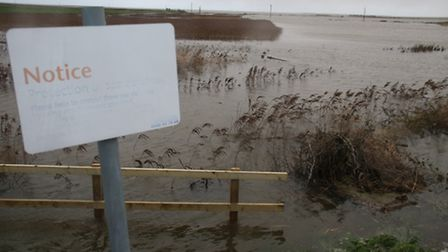 This notice at Cley asked the public to please help protect sea defences. Picture: ALLY McGILVRAY