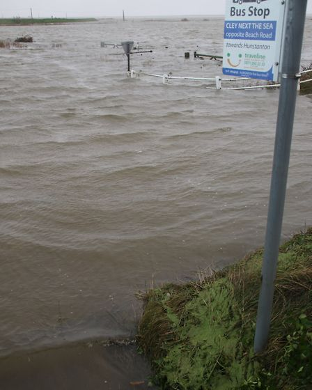 The aptly named Beach Road bus stop in Cley was submerged in water following the storm surge. Pictur