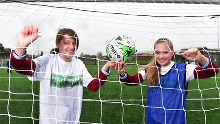 Izzy Collins and Summer Whiting on the new 3G astro turf football pitch in Long StrattonPHOTO: Nic