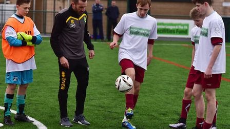 Darren Huckerby working with year 10 students on the new LONG Stratton 3G astro turf football pitch