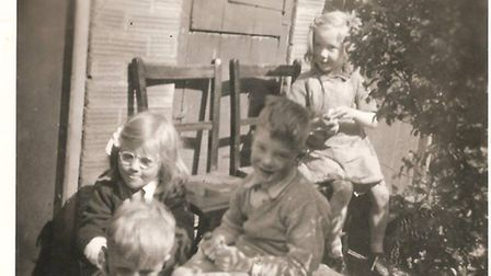 Michael Dunn's two brothers, sister and cousin in the back garden in Botolph Street, 1951. Photo: Mi