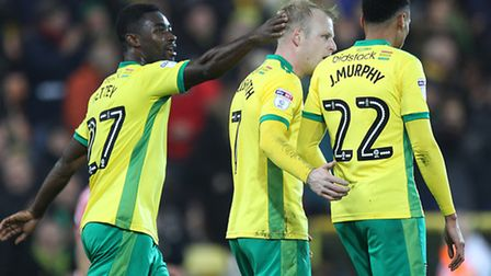 Alexander Tettey of Norwich congratulates Steven Naismith of Norwich on his goal during the third ro