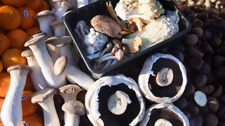 King Oyster mushrooms, left, and flat field mushrooms, with a selection of wild mushrooms at Mike, D