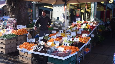 Mike and Debs Read at their family fruit and veg stall at Norwich Market. Picture: DENISE BRADLEY