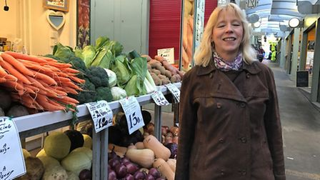 Ceri Lamb shopping on Mike, Debs and Sons fruit and vegetable stall. Photo: Geraldine Scott