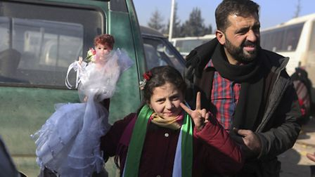 Syrians evacuated from the embattled Syrian city of Aleppo. Pic: AP Photo.