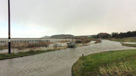 The A149 at Cley is flooded following last night's storm surge. Picture James Horne