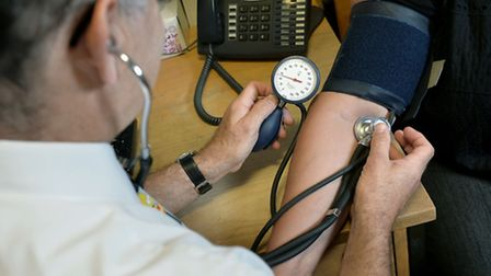 File photo of GP checking a patient's blood pressure. Picture Press Association.
